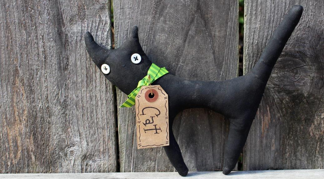 Little, Black, Button-Eyed Cat